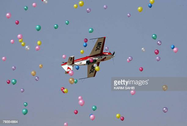 Balloons fly as Zoltan team from Hungary performs during the AlAin International Aerobatics Show at the Gulf emirate's airport 27 January 2008 AFP...