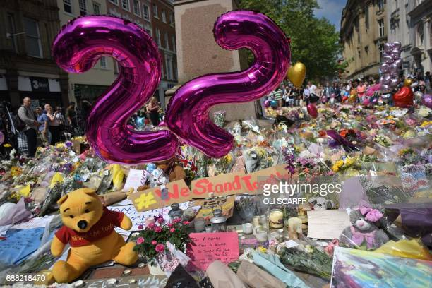 Balloons forming the number 22 are pictured alongside flowers and messages of support in St Ann's Square in Manchester northwest England on May 25...