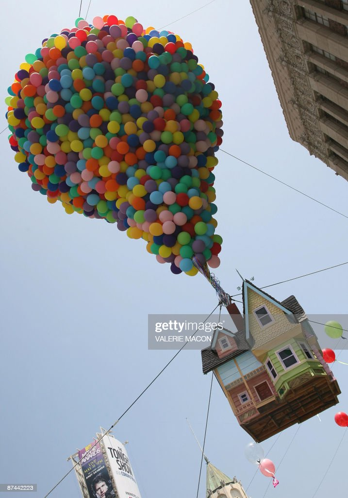 Balloons hold up a house at the premiere of Disney Pixar's 'Up' at the El Capitan Theatre in Hollywood on May 16 2009 AFP PHOTO/VALERIE MACON