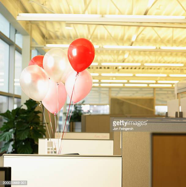 Balloons in office cubicle