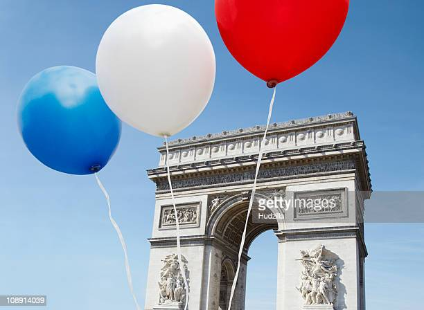 Balloons in the colors of the French flag in front of the Arc De Triomphe
