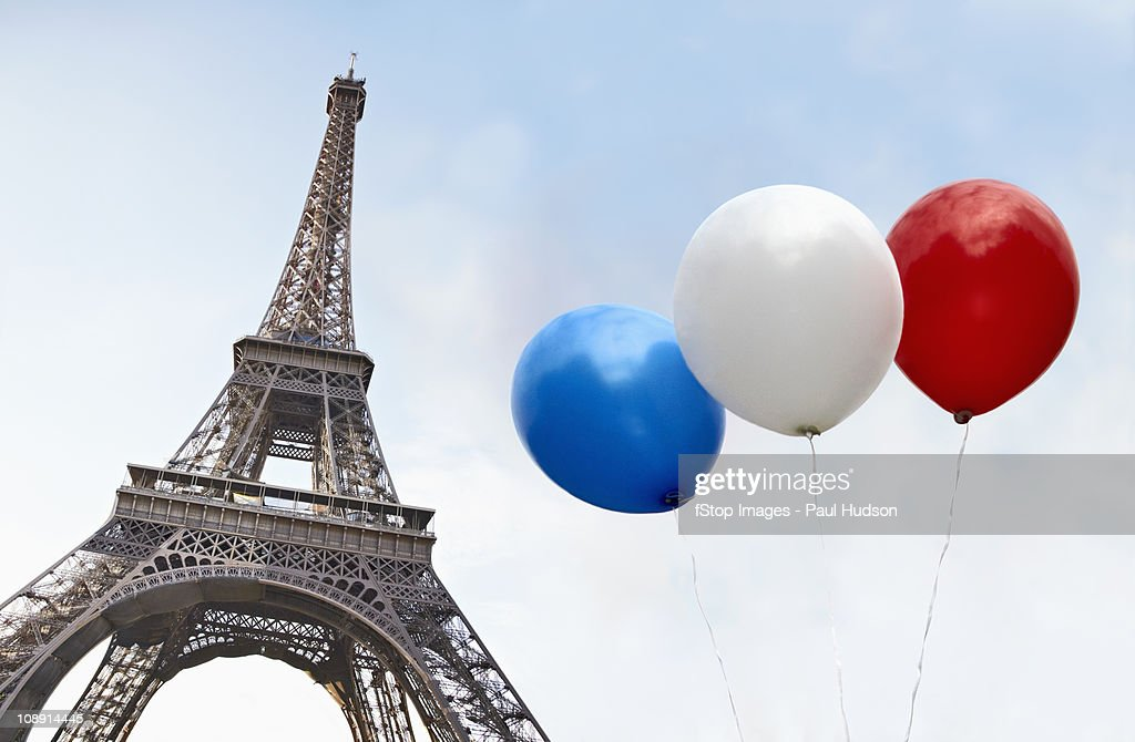 Balloons in the colors of the French flag in front of the Eiffel Tower