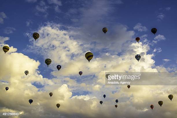 Balloons launch from Balloon Fiesta field and float above the crowd as they just take off during the Albuquerque International Balloon Fiesta in New...