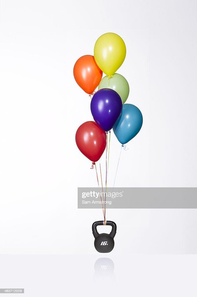 Balloons lifting weight