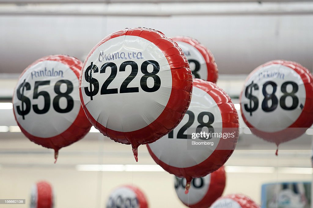 Balloons marked with discounted specials hang from the ceiling inside a Wal-Mart de Mexico SAB de CV in Mexico City, Mexico on Saturday, Nov. 17, 2012. El Buen Fin, Mexico's equivalent of Black Friday, when the year's biggest discounts are offered by participating stores, is held on the third weekend of November and will run through Nov. 19. Photographer: Susana Gonzalez/Bloomberg via Getty Images