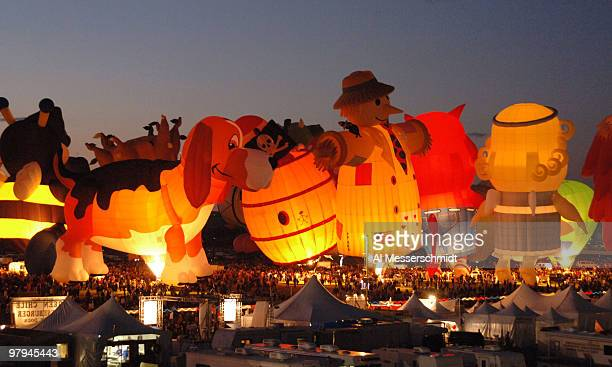 Balloons of all sizes and shapes glow in the dark at an evening glowdoe event at the Albuquerque International Balloon Fiesta October 6 1005