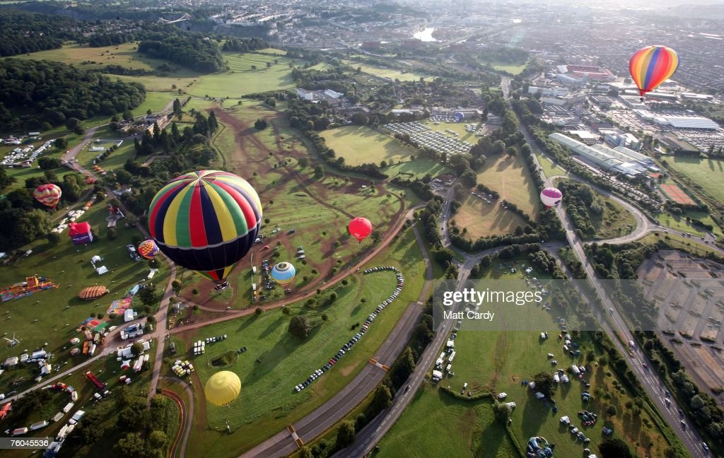 Balloons participating in the mass early morning ascent start to rise in to the skies above Ashton Court at the Discovery Channel International...