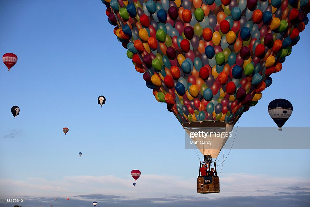 Balloons take to the skies on the first day of the Bristol International Balloon Fiesta at the Ashton Court estate on August 6 2015 in Bristol...