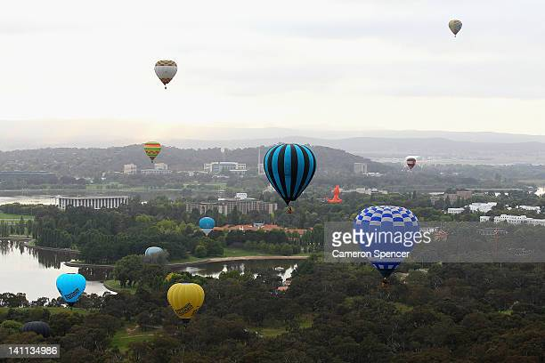Balloons takeoff in the Balloon Spectacular during Canberra Festival on March 11 2012 in Canberra Australia The annual balloon festival in Canberra...