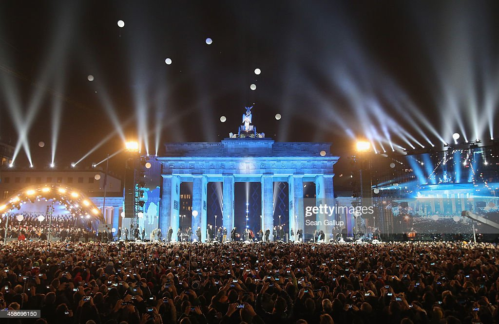 Balloons that are part of a light installation rise into the air to symbolize the collapse of the Berlin Wall in front of the Brandenburg Gate during celebrations on the 25th anniversary of the fall of the Berlin Wall on November 9, 2014 in Berlin, Germany. The city of Berlin is commemorating the 25th anniversary of the fall of the Berlin Wall with an installation of 6,800 lamps coupled with illuminated balloons along a 15km route where the Wall once ran and divided the city into capitalist West and communist East. The fall of the Wall on November 9, 1989, was among the most powerful symbols of the revolutions that swept through the communist countries of Eastern Europe and heralded the end of the Cold War. Built by the communist authorities of East Germany in 1961, the Wall prevented East Germans from fleeing west and was equipped with guard towers and deadly traps.