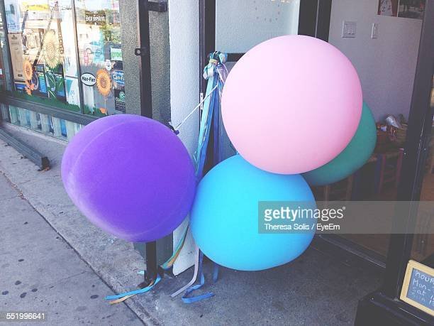 Balloons Tied Outside Shop