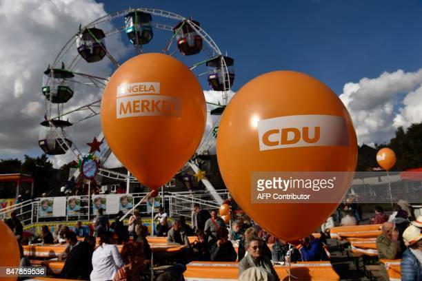Balloons with German Chancellor Angela Merkel's name are seen at a fair as she continued on the election campaign trail in Stralsund on September 16...
