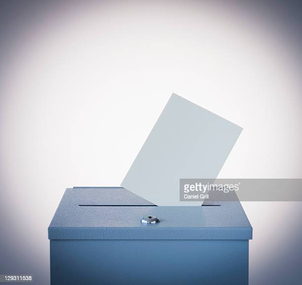 Ballot box and blank paper, studio shot