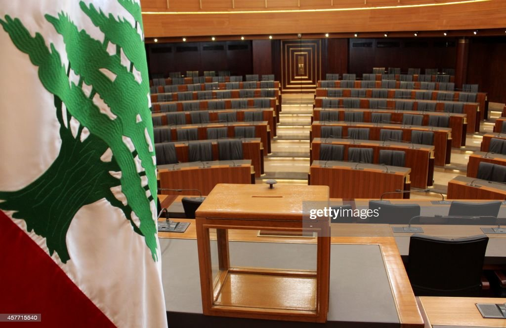 A ballot box sits on a table next to the national flag at the Lebanese Parliament in the capital Beirut on April 22, 2014 ahead of tomorrow's presidential election. Lebanon's parliament convenes tomorrow to try to elect a new president without a clear frontrunner in sight because of deep divisions over the Syrian conflict and Hezbollah's arsenal.
