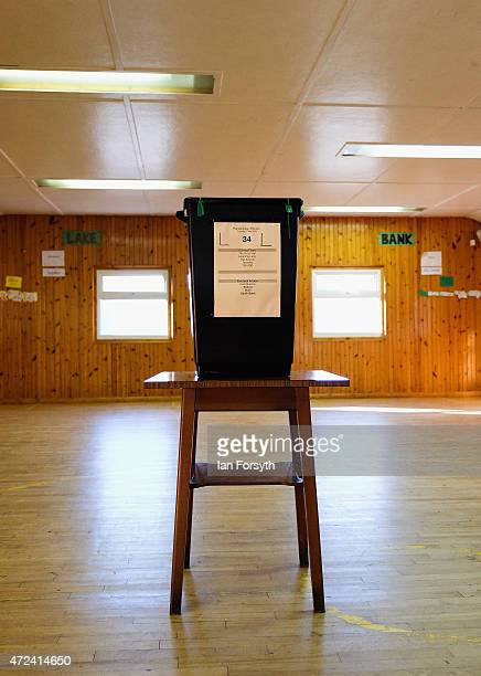 A ballot box stands in the centre of a room at a polling station situated inside a scout hut on May 7 2015 in Eston England The nation goes to the...