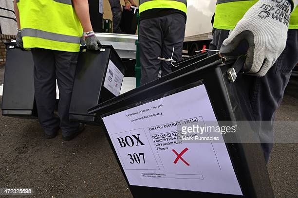 Ballot Boxes are loaded onto trucks by staff at Glasgow City Council's 'City Building' depot in Queenslie on the eve of the General Election on May...