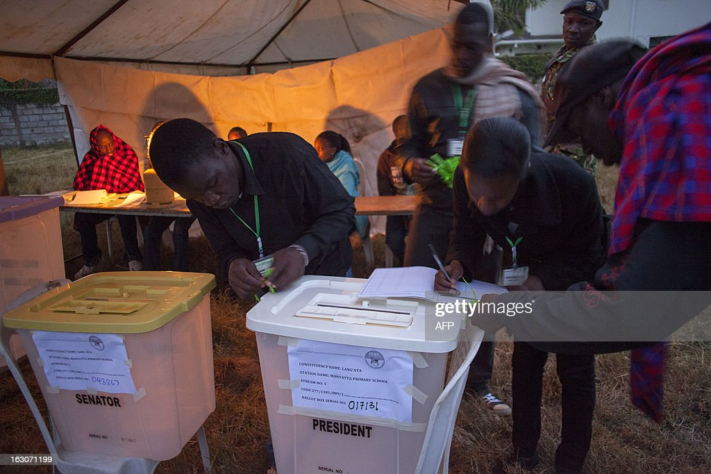 Ballot boxes at Manyatta Primary School polling station in Langata, a suburb of Nairobi, are checked at dawn by officials from the Independent Electoral and Boundaries Commission (IEBC) before voting opens on March 4, 2013 during the elections. Long lines of Kenyans queued from way before dawn to vote Monday in the first election since the violence-wracked polls five years ago, with a deadly police ambush hours before polling started marring the key ballot. The tense elections are seen as a crucial test for Kenya, with leaders vowing to avoid a repeat of the bloody 2007-8 post-poll violence in which over 1,100 people were killed and observers repeatedly warning of the risk of renewed conflict. AFP PHOTO / GEORGINA GOODWIN