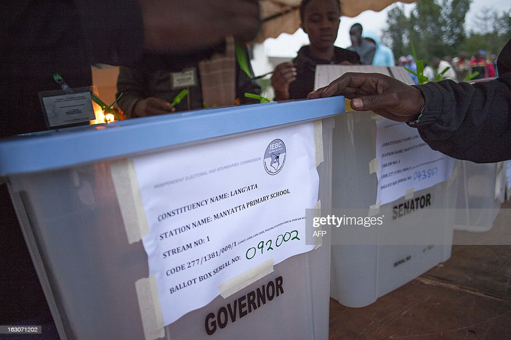 Ballot boxes at Manyatta Primary School polling station in Langata, a suburb of Nairobi, are checked at dawn by officials from the Independent Electoral and Boundaries Commission (IEBC) before voting opens on March 4, 2013 during the elections. Long lines of Kenyans queued from way before dawn to vote Monday in the first election since the violence-wracked polls five years ago, with a deadly police ambush hours before polling started marring the key ballot. The tense elections are seen as a crucial test for Kenya, with leaders vowing to avoid a repeat of the bloody 2007-8 post-poll violence in which over 1,100 people were killed and observers repeatedly warning of the risk of renewed conflict.