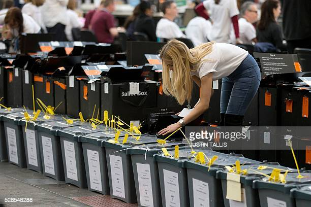 Ballot boxes containing voting slips wait to be opened ahead of counting at a count centre in north London on May 6 2016 Early results Friday from...