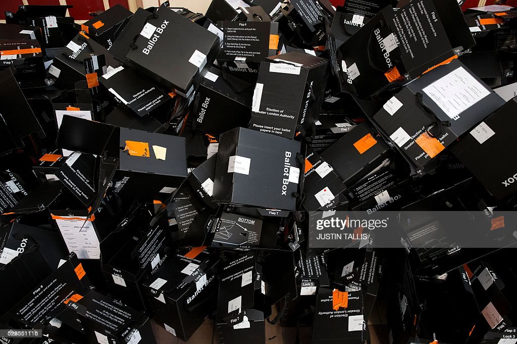 Ballot boxes lay discarded after having been emptied of their ballot papers at a count centre in north London on May 6, 2016. Early results Friday from British local and regional elections seen as a key test for opposition Labour leader Jeremy Corbyn showed strong gains for Scottish nationalists, as London looked set to elect its first Muslim mayor. London was on track to become the first EU capital with a Muslim mayor as voters went to the polls Thursday after a bitter campaign between Prime Minister David Cameron's Conservatives and the opposition Labour party. / AFP / JUSTIN