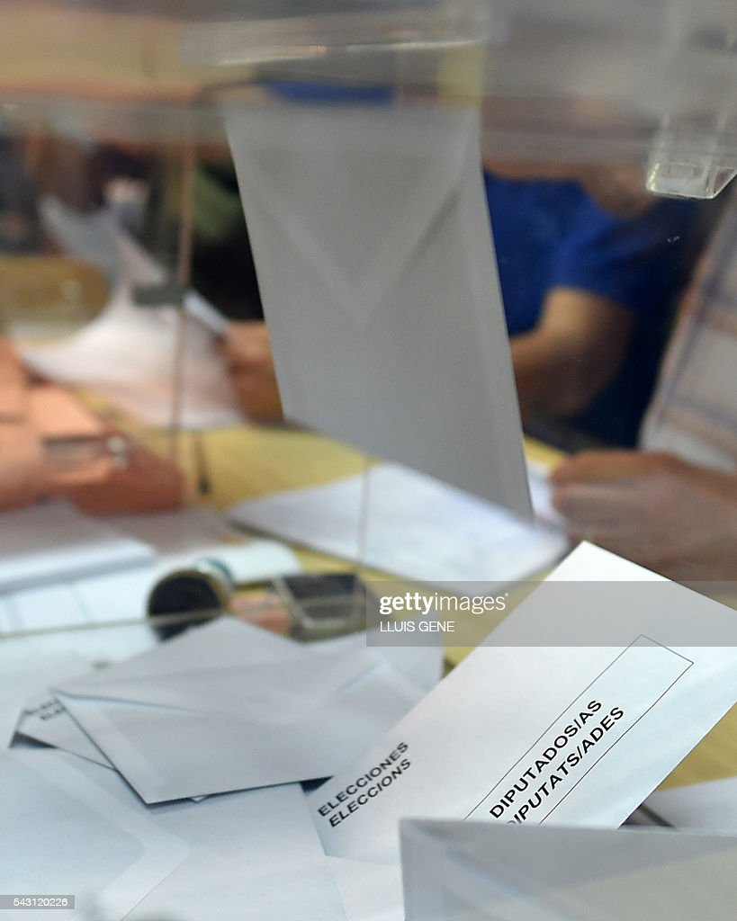 A ballot is cast in Spains general election at a polling station in Hospitalet, near Barcelona on June 26, 2016. Spain votes today, six months after an inconclusive election which saw parties unable to agree on a coalition government. GENE