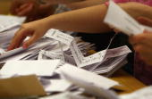 Ballot papers are counted during the 2010 General Election Count at Redditch Town Hall in the Redditch constituency of Jacqui Smith on May 7 2010 in...