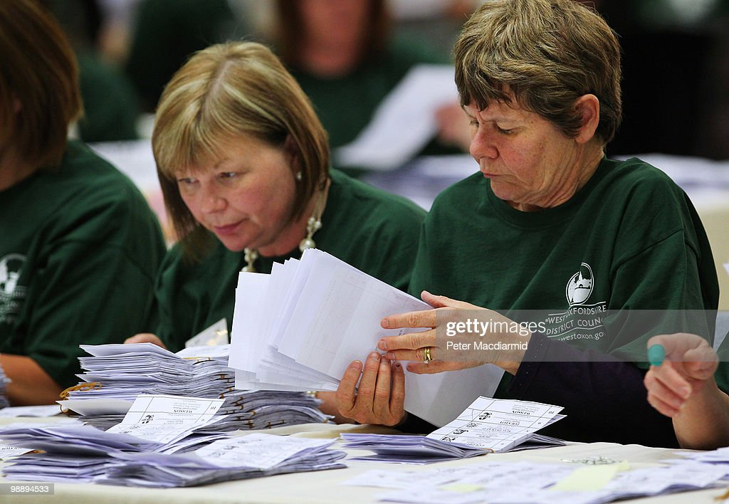 Ballot papers are counted in the constituency of Conservative Party leader David Cameron on May 7, 2010 in Witney, England. After 5 weeks of campaigning, including the first ever live televised Leader's Debates, opinion polls suggest that the UK is facing the prospect of a hung parliament for the first time since 1974.