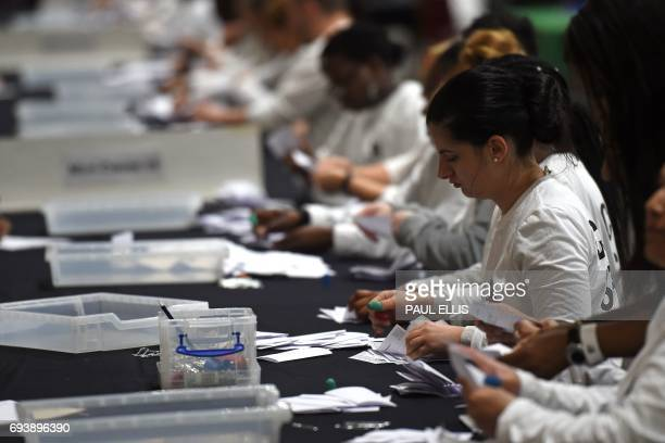 Ballot papers are sorted at the counting centre at Alexandra Palace in London on June 8 2017 after the polls closed in the British general election...