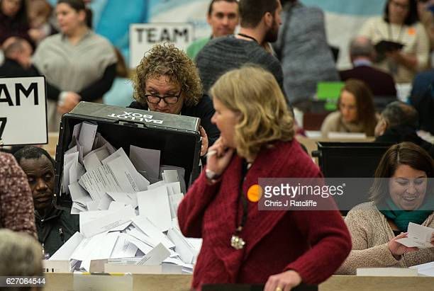 Ballot papers are tipped on to a bench in front of count staff during the Richmond Park byelection count at Richmond Upon Thames College on December...