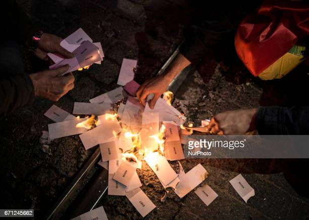 Ballot papers burning are pictured on April 20 2017 in Istanbul Turkey during the protesters march in opposition to perceived voting irregularities...