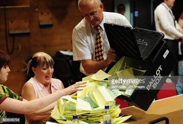 Ballot papers for the Local and European Parliament elections are emptied from a ballot box before being sorted and counted in Preston