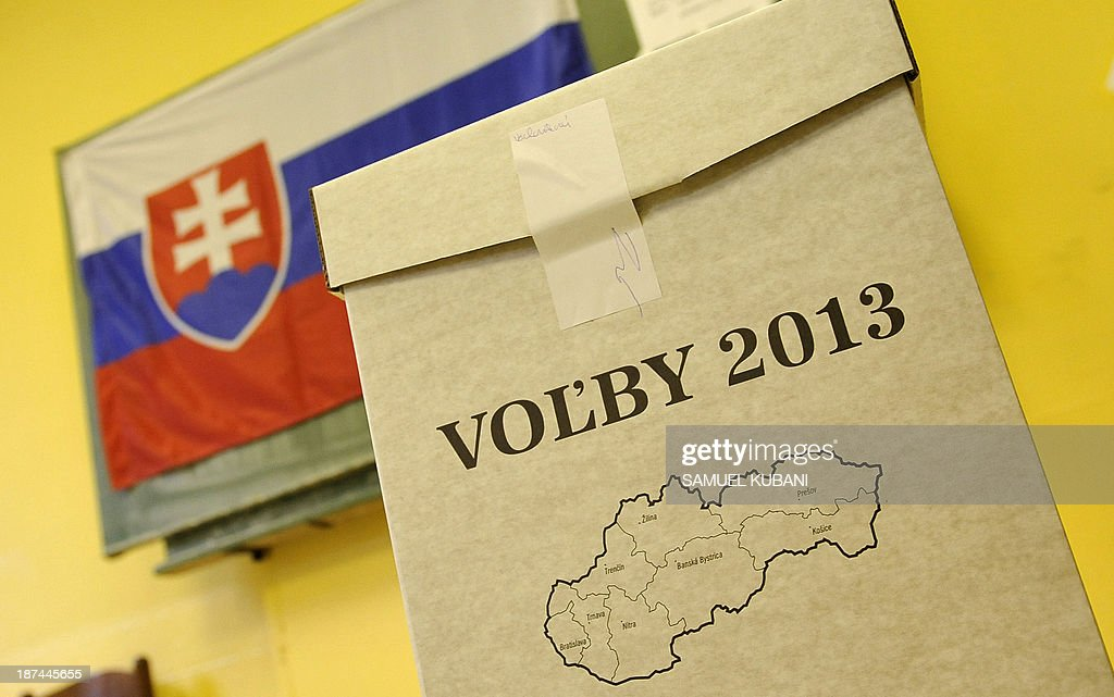 A ballot-box and a flag of Slovakia are seen during the elections for the regional councils and the first round of the gubernatorial elections in Bratislava on November 9, 2013. The second round of the gubernatorial elections is scheduled for two weeks later on November 23 in the regions in which none of the candidates receives more than 50 percent of the vote.