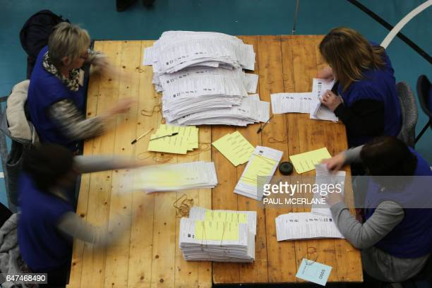 Ballots are counted by count staff at the MidUlster count for the Northern Ireland Assemby elections in Ballymena Co Antrim Northern Ireland on March...