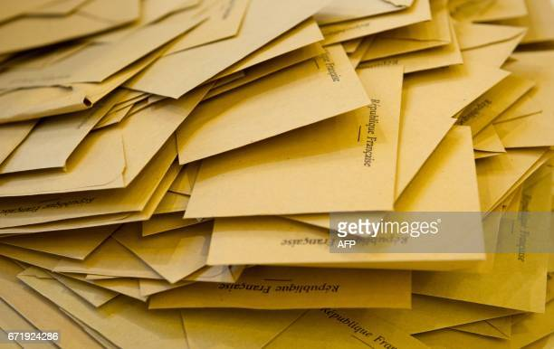 TOPSHOT Ballots are pictured on a table before being counted on April 23 2017 in Quimper western France during the frist round of the Presidential...