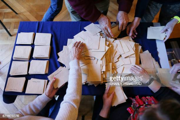 Ballots are prepared for counting at a polling station in Rouen northern France during the first round of the French presidential elections on April...