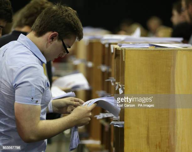 Ballots are sorted as a full recount is called in the European Parliamentary elections count at the RDS in Dublin