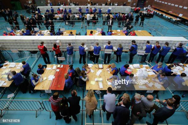 Ballots are sorted by count staff at the MidUlster count for the Northern Ireland Assemby elections in Ballymena Co Antrim Northern Ireland on March...