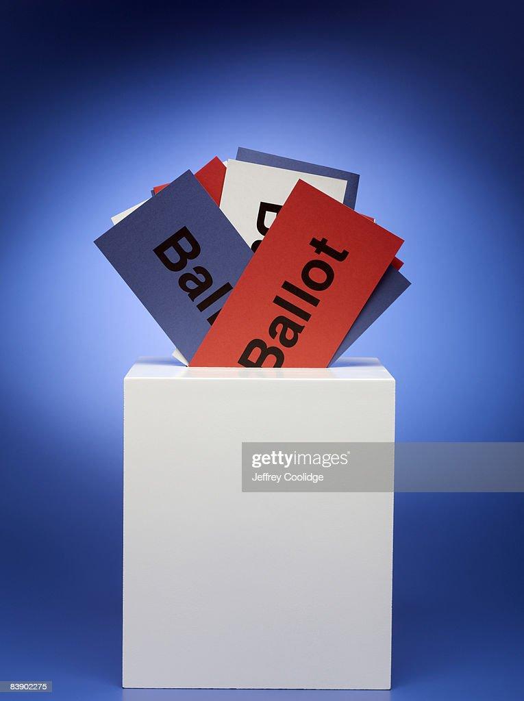 Ballots stuffed in ballot box : Stock Photo