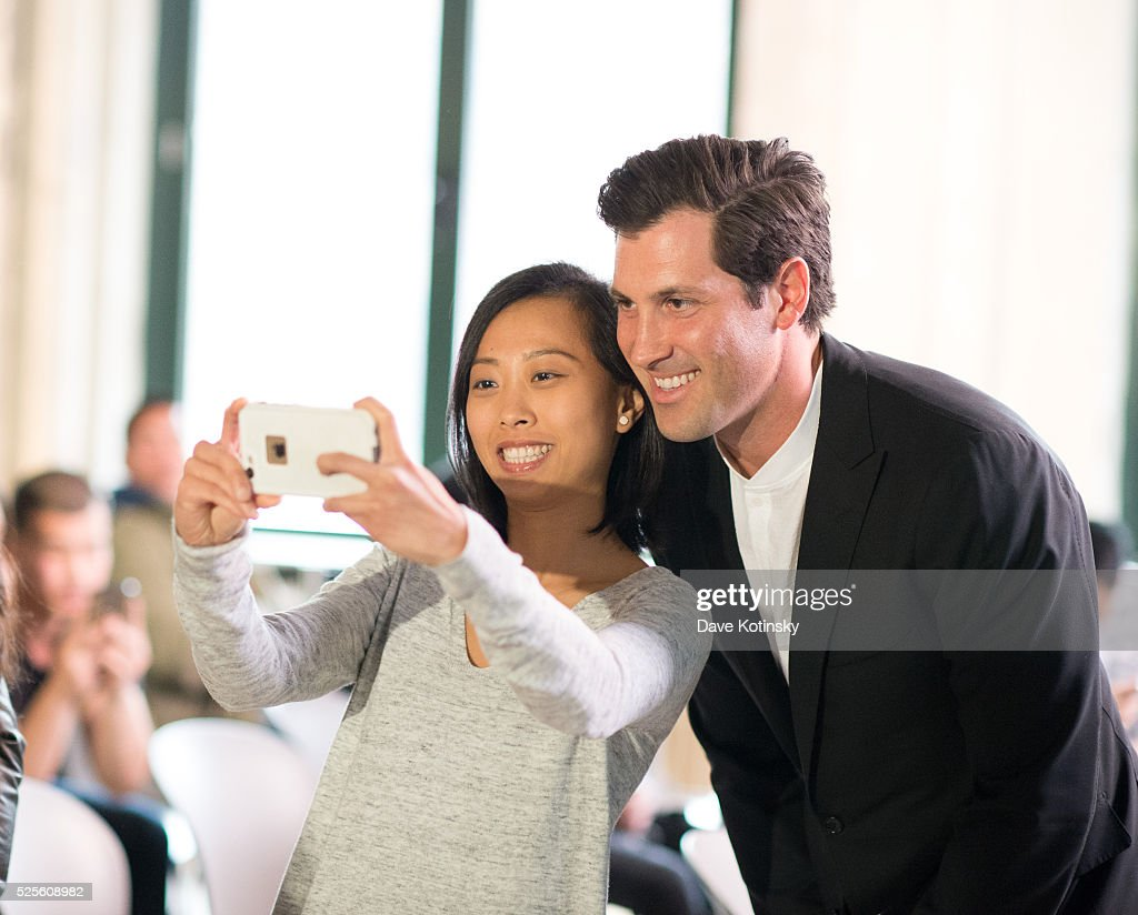 Ballroom Dance Champion Maksim Chmerkoviskiy greets and poses with fans at AOL Studios at AOL Build In New York on April 28, 2016 in New York City.