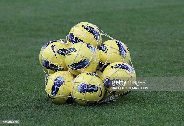 Balls are seen on the field prior to the start of the friendly football match France vs Belgium on November 15 2011 at the Stade de France in...