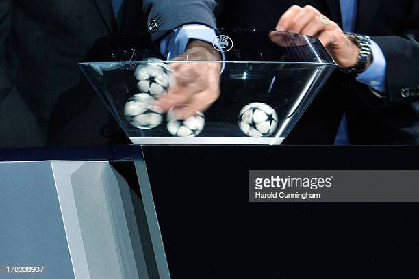 Balls are shuffled during the UEFA Champions League group stage 2013/14 draw on August 29 2013 in Monaco Monaco