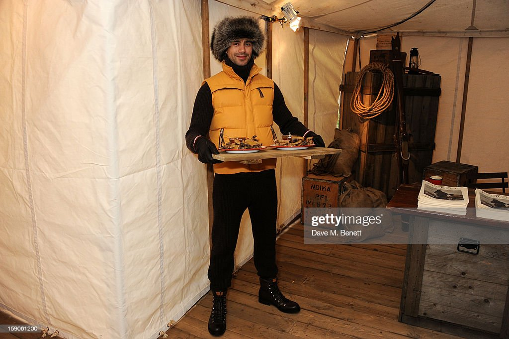 A Bally model holds refreshments during the 'BALLY Celebrates 60 Years of Conquering Everest' at Bedford Square Gardens on January 7, 2013 in London, England.