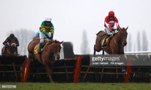 Ballyandy ridden by Sam TwistonDavies clears the klast flight in company with Movewithetimes ridden by Barry Geraghty before going on to win The...