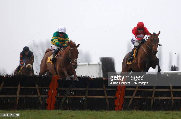 Ballyandy ridden by Sam TwistonDavies clears the last flight in company with Movewithetimes ridden by Barry Geraghty before going on to win The...