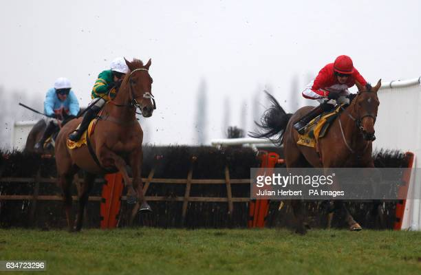 Ballyandy ridden by Sam TwistonDavies pulls away from the last flight in company with Movewithetimes ridden by Barry Geraghty before going on to win...
