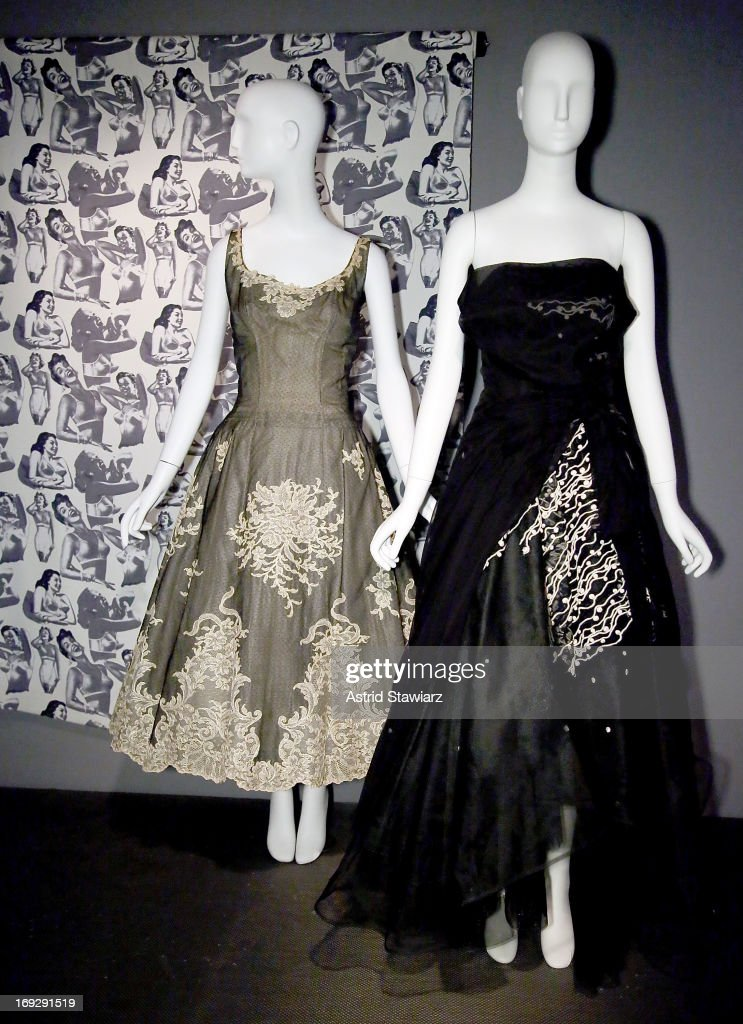 A Balmain dress, circa 1948 is displayed next to a Marc Jacobs dress, circa 2008 at the RetroSpective Press Preview at The Museum at FIT on May 22, 2013 in New York City.