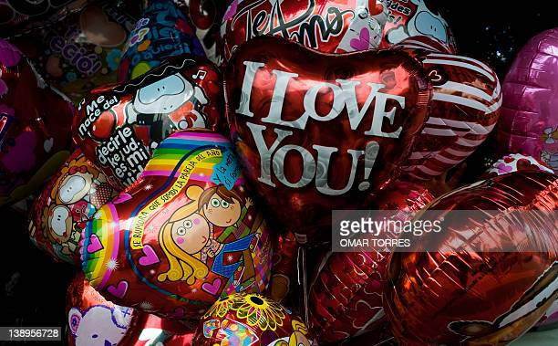 Baloons with inscriptions celebrating Saint Valentine's day for sale at a stand at a street of Mexico City on February 14 2012 AFP PHOTO/OMAR TORRES