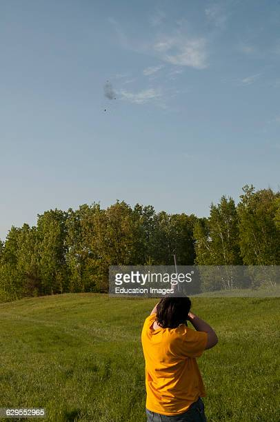 Balsam Lake Wisconsin Skeet shooting 12 gauge shotgun 13 year old teenager hitting the clay target in the air