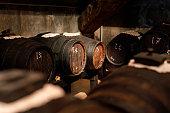 Old oak barrel used for the production of balsamic vinegar at balsamic vinegar facility near Modena, Italy