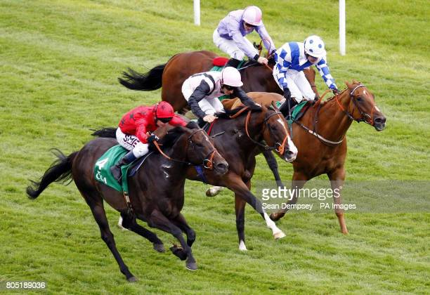 Balthazaar's Gift ridden by Jockey Philip Robinson go on to win the Cga Hungerford Stakes during the CGA Ladies Day at Newbury Racecourse Berkshire